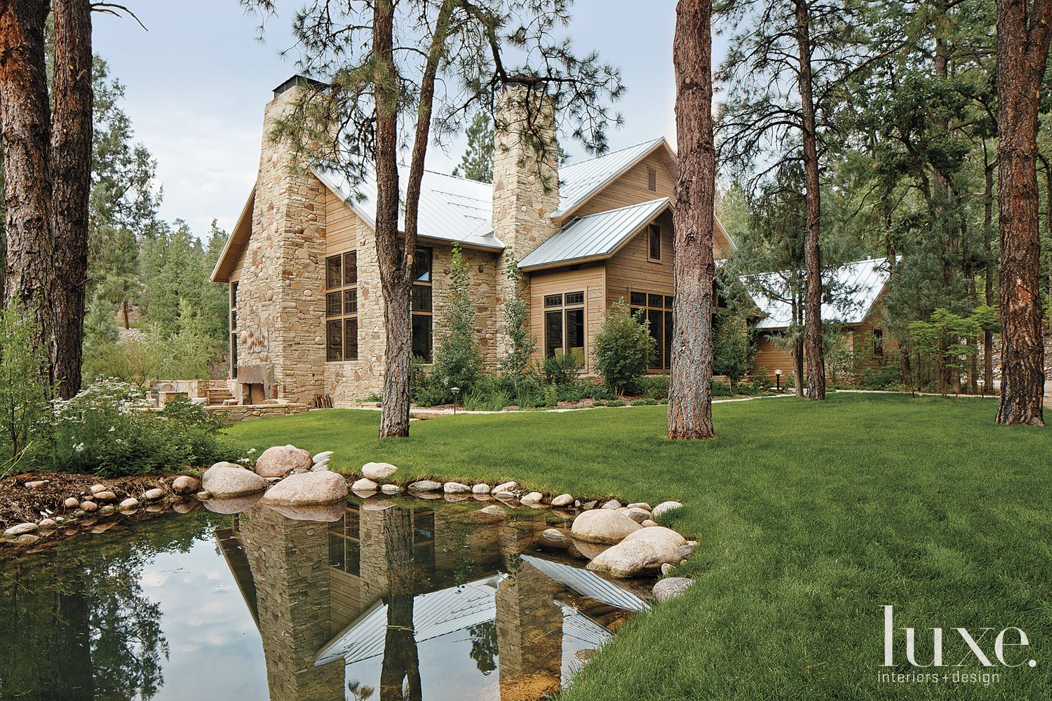 Country Neutral Exterior with Stone Pond