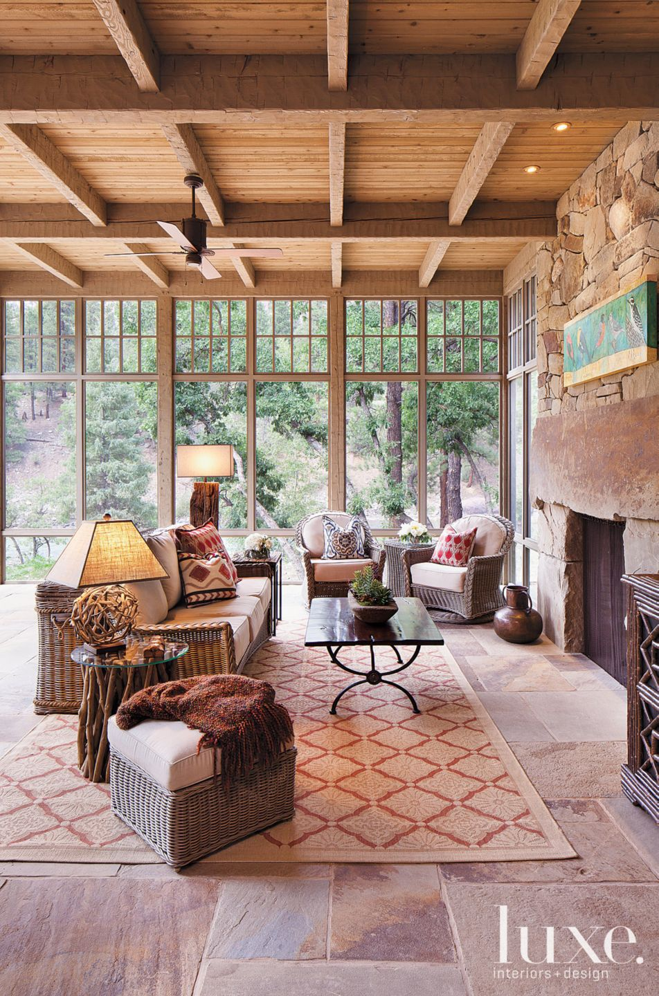 Country Neutral Screened Porch with Rustic Furnishings