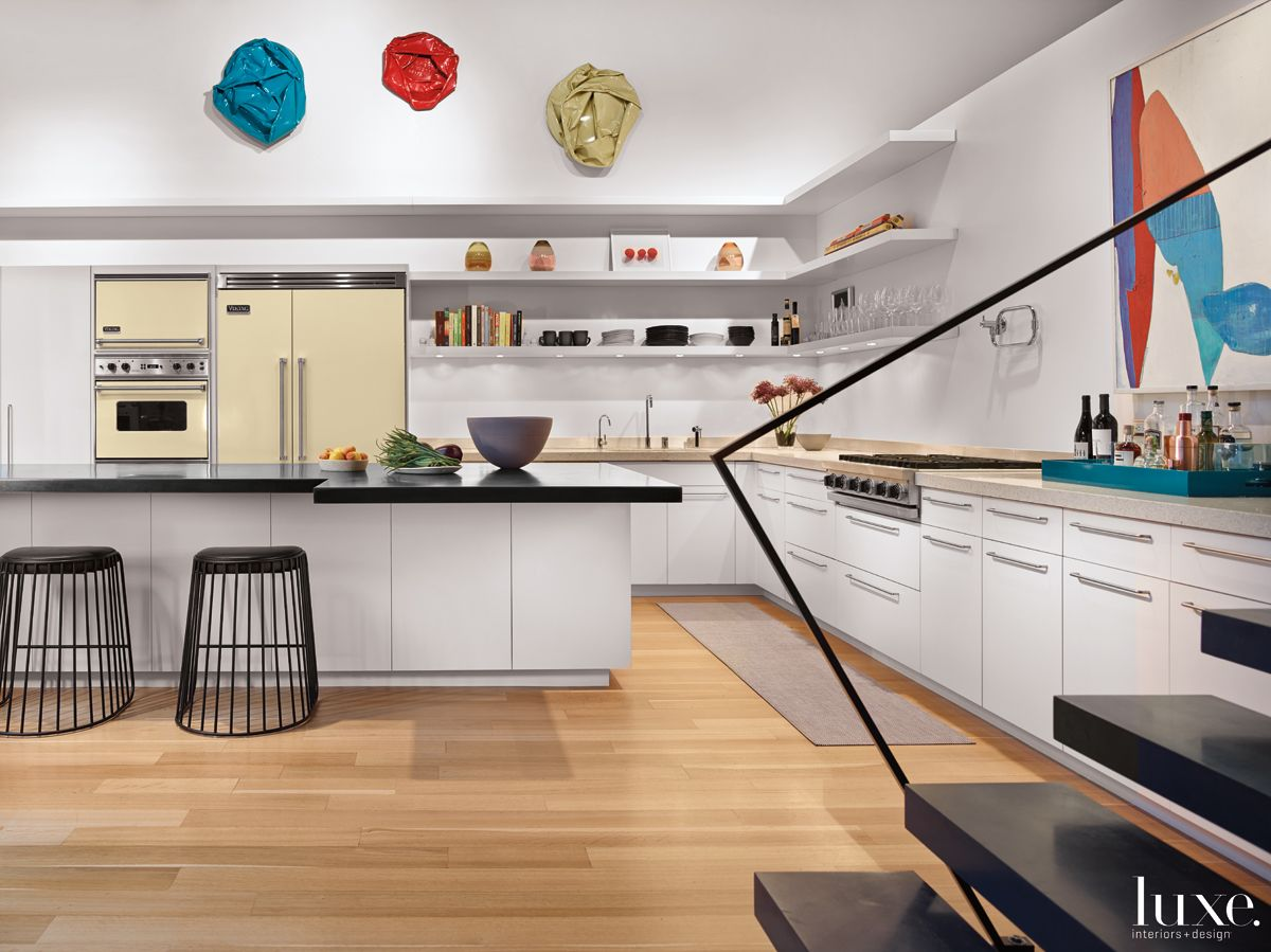 Modern White Kitchen with Oil Drum Art