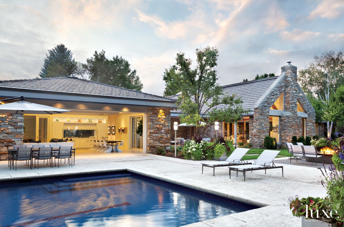Modern Neutral Pool House with Pocket Doors