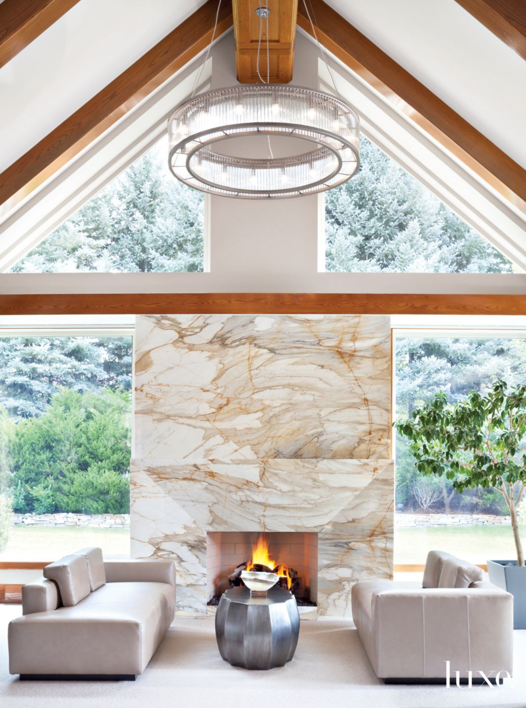 Modern White Great Room with Marble Fireplace
