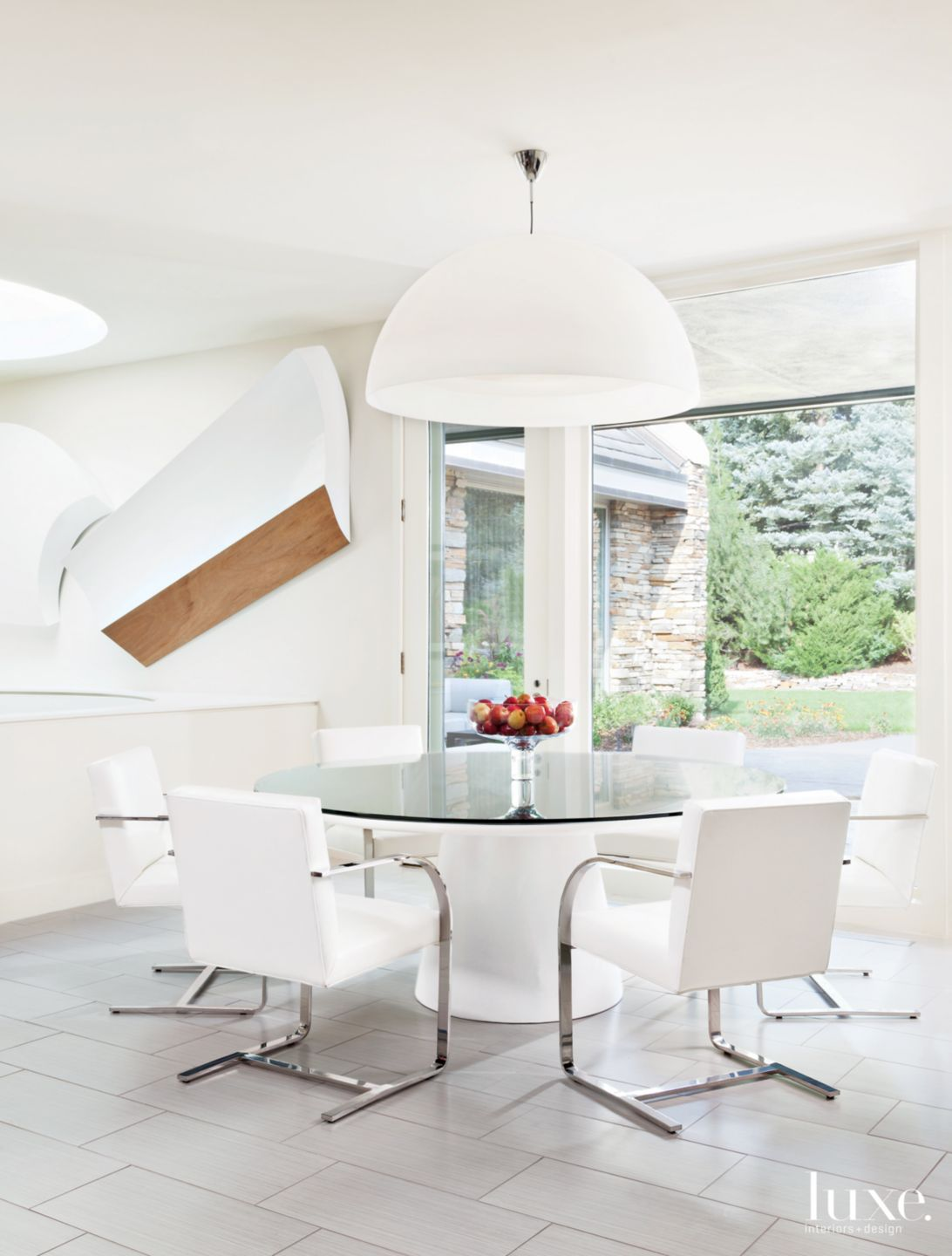 Modern White Breakfast Area with Wall Sculptures