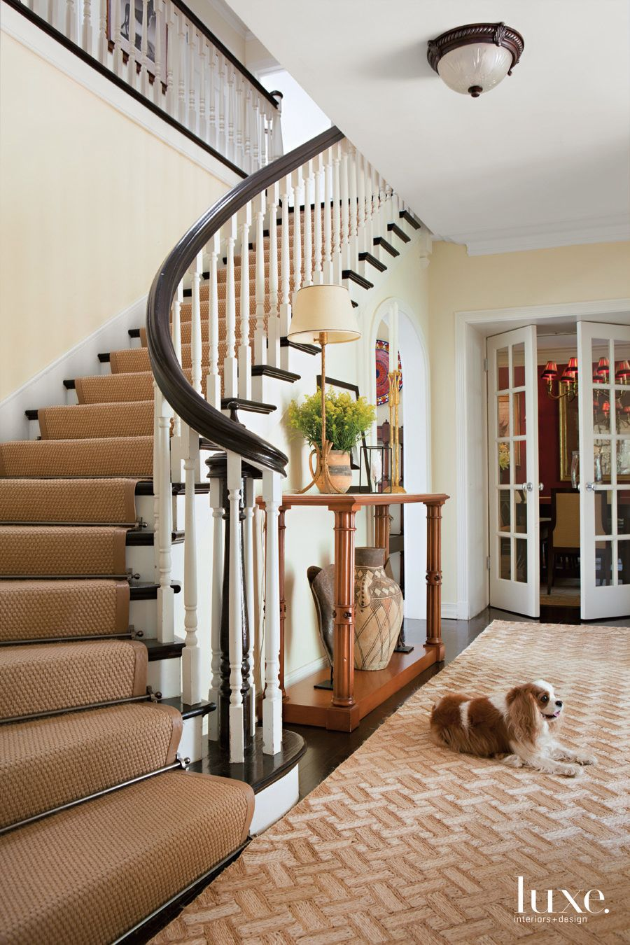 Traditional Neutral Hall with Paul Revere Williams Staircase