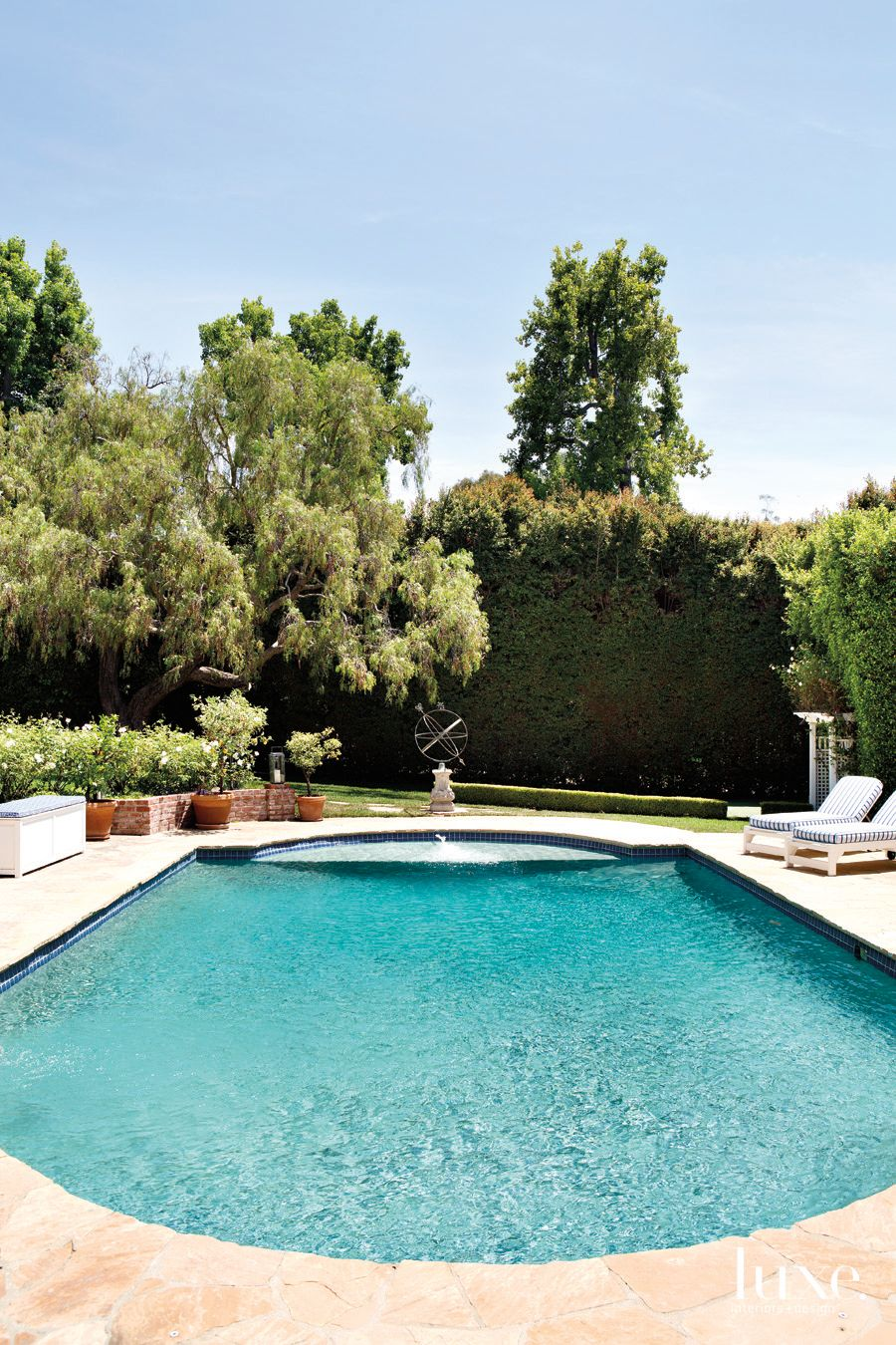 Traditional Neutral Pool Area with Striped Chaises