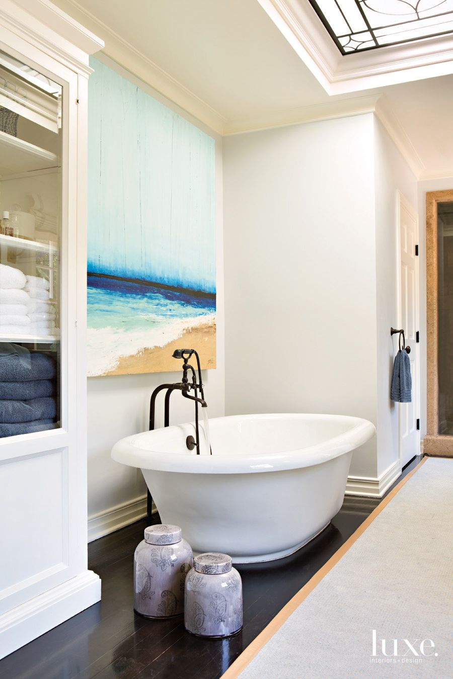 Traditional White Bathroom with Ocean-Inspired Artwork