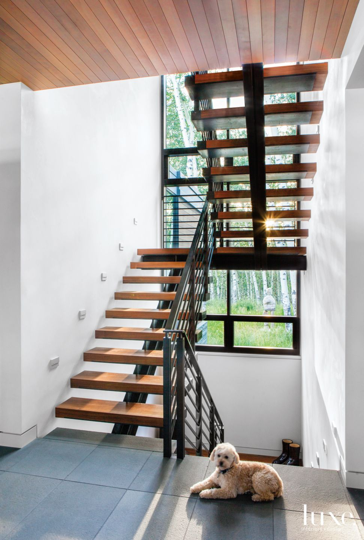 Modern Neutral Stairway with Narrow Window