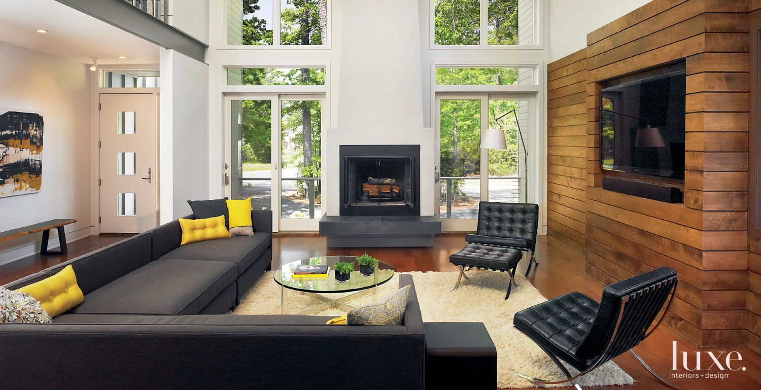 Modern White Living Room with Maple-Clad Wall