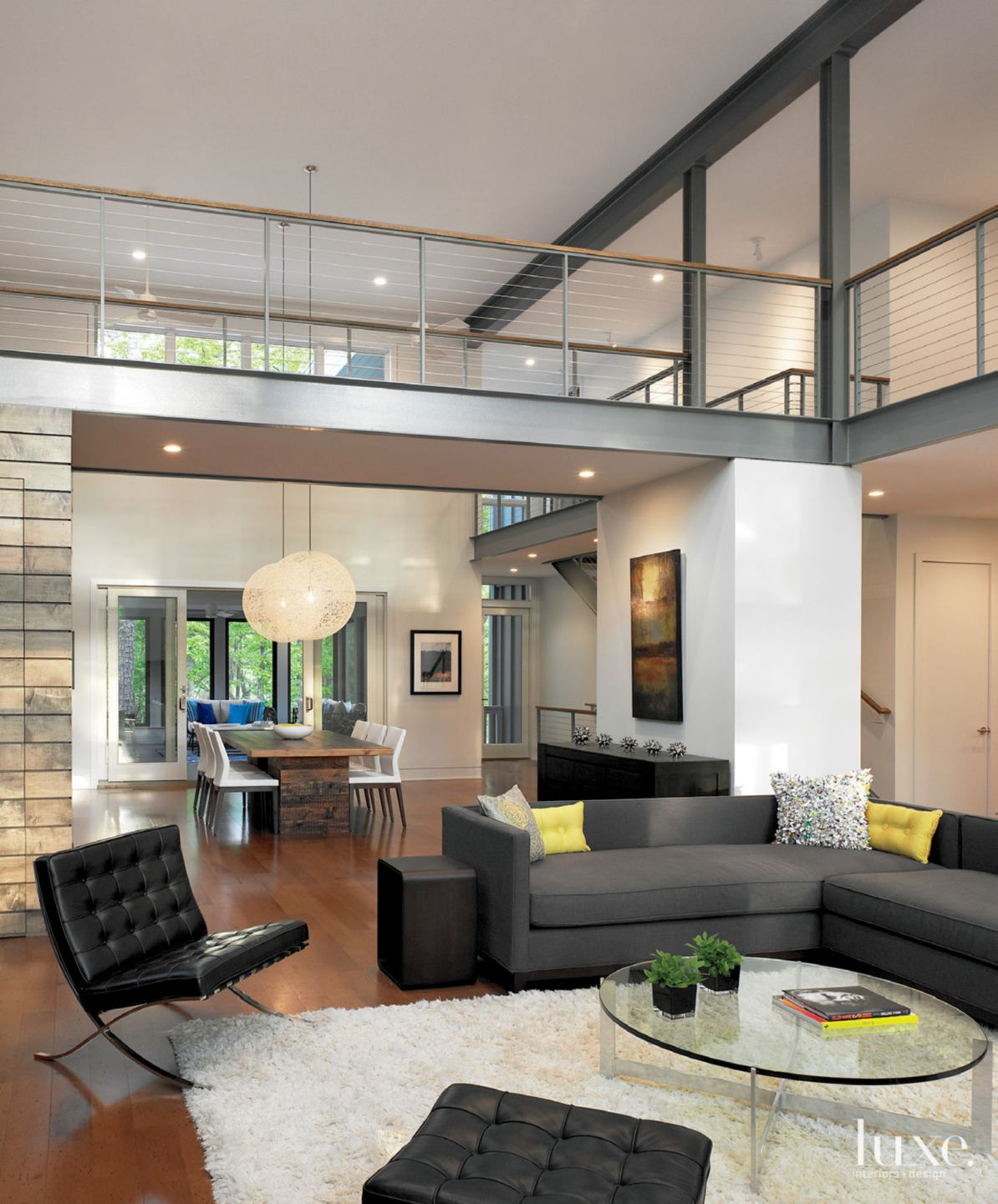 Modern White Great Room with Exposed Steel Beams