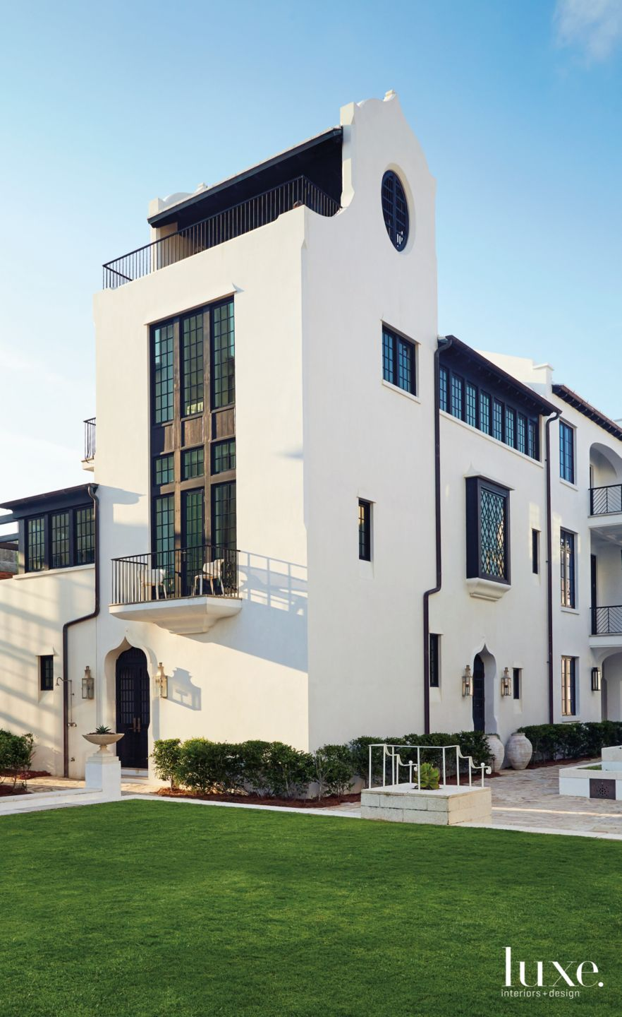 Modern White Exterior with Mullioned Windows