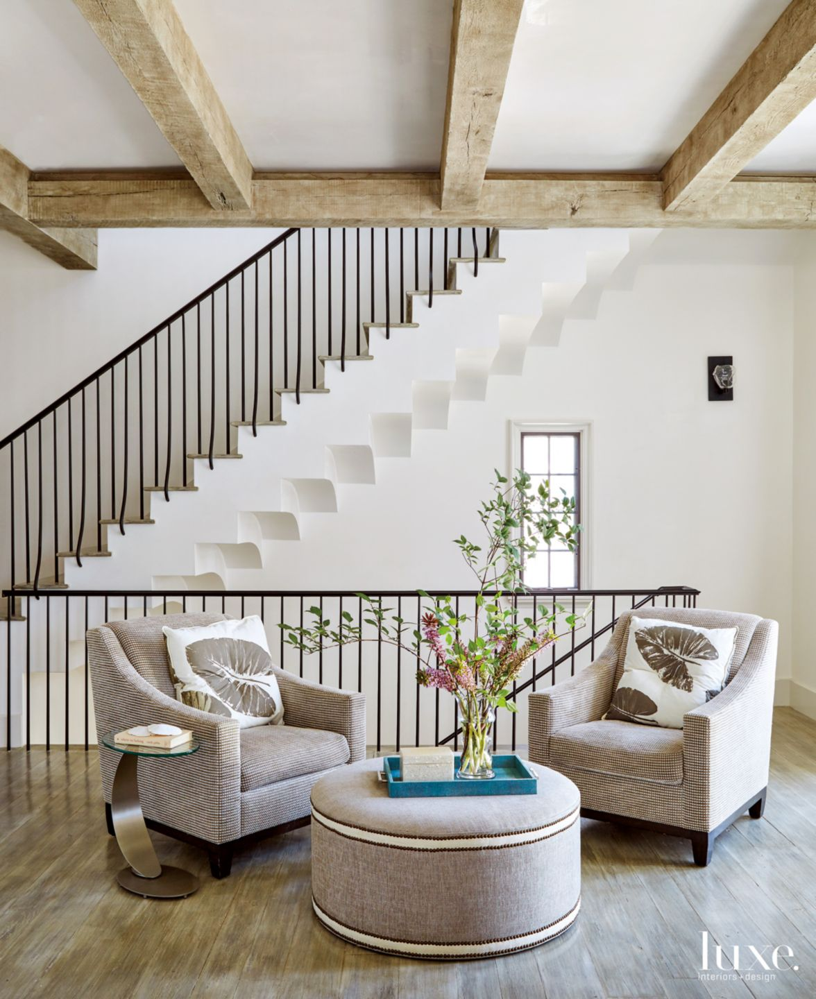 Modern Neutral Seating Area with Wall Staircase