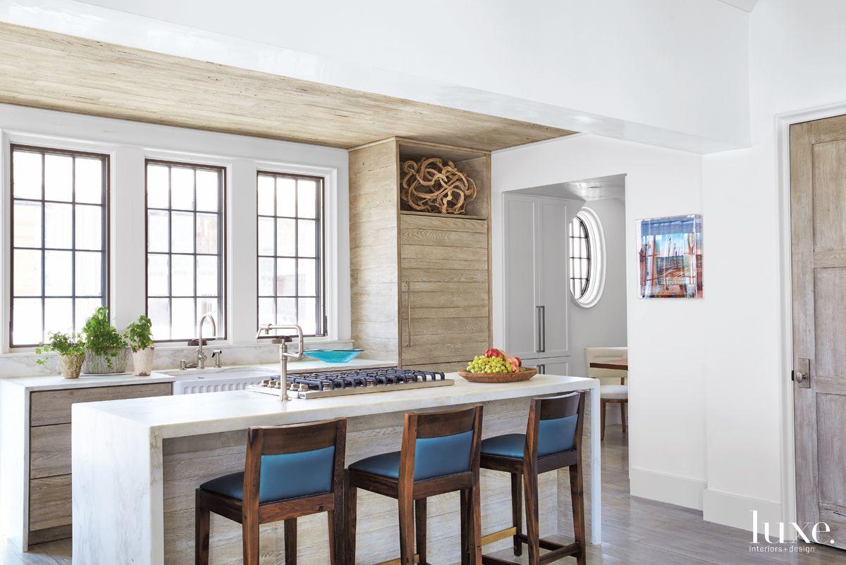 Modern Neutral Kitchen with Wood-Clad Refrigerator