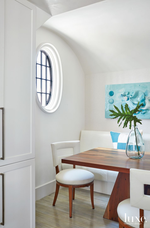 Modern White Breakfast Area with Circular Window