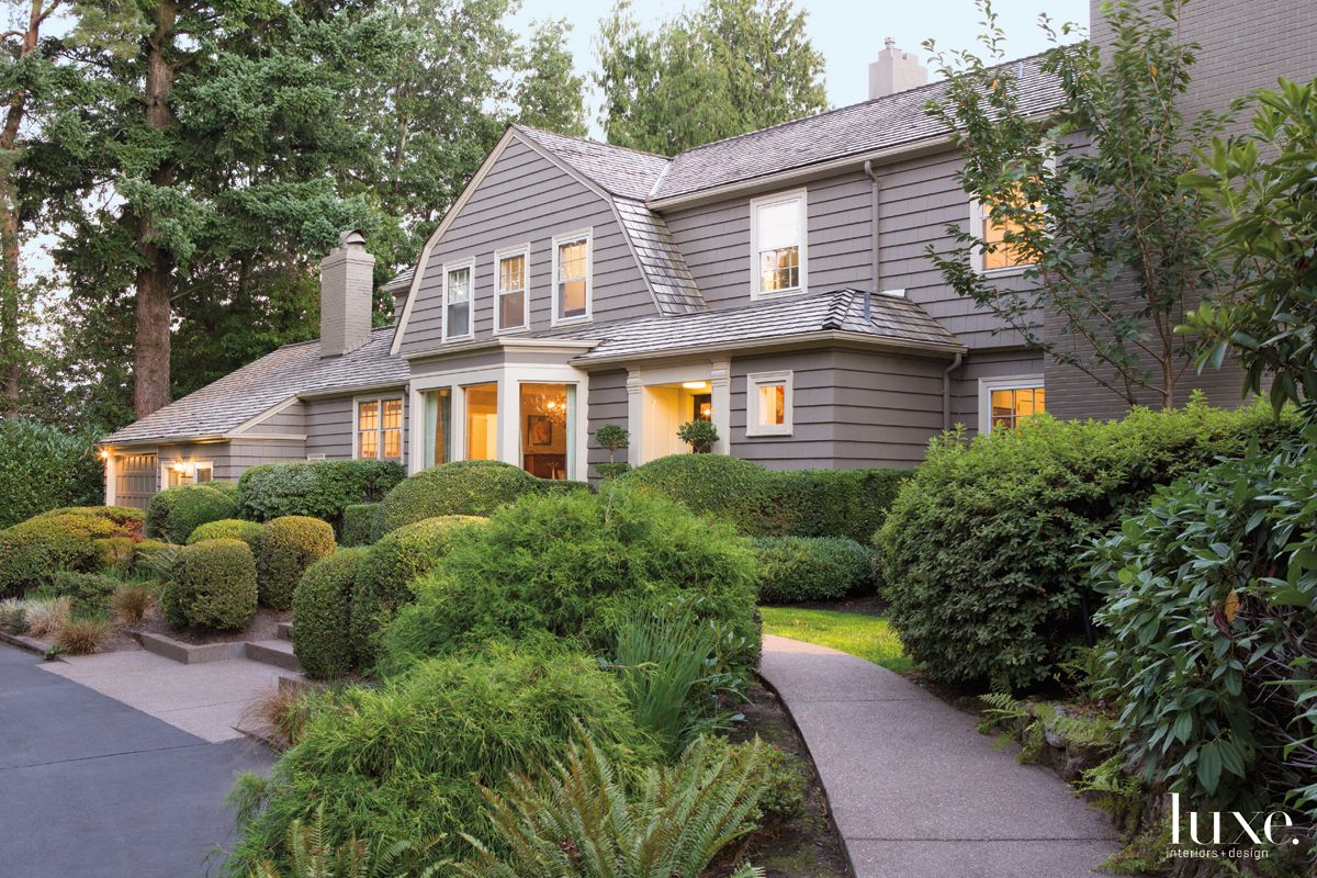 Traditional Neutral Dutch Colonial Exterior with Original Millwork