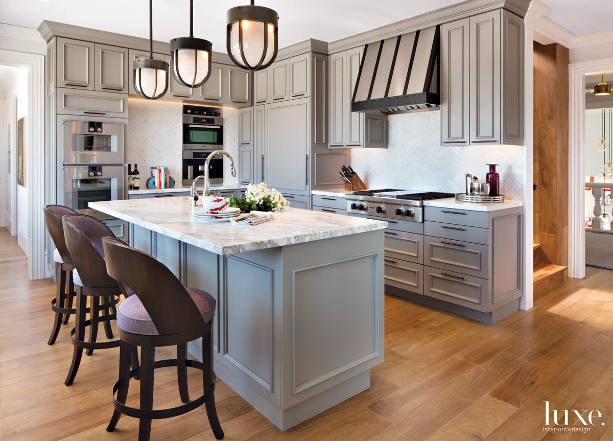 Eclectic Gray Kitchen with Frosted Glass Pendants