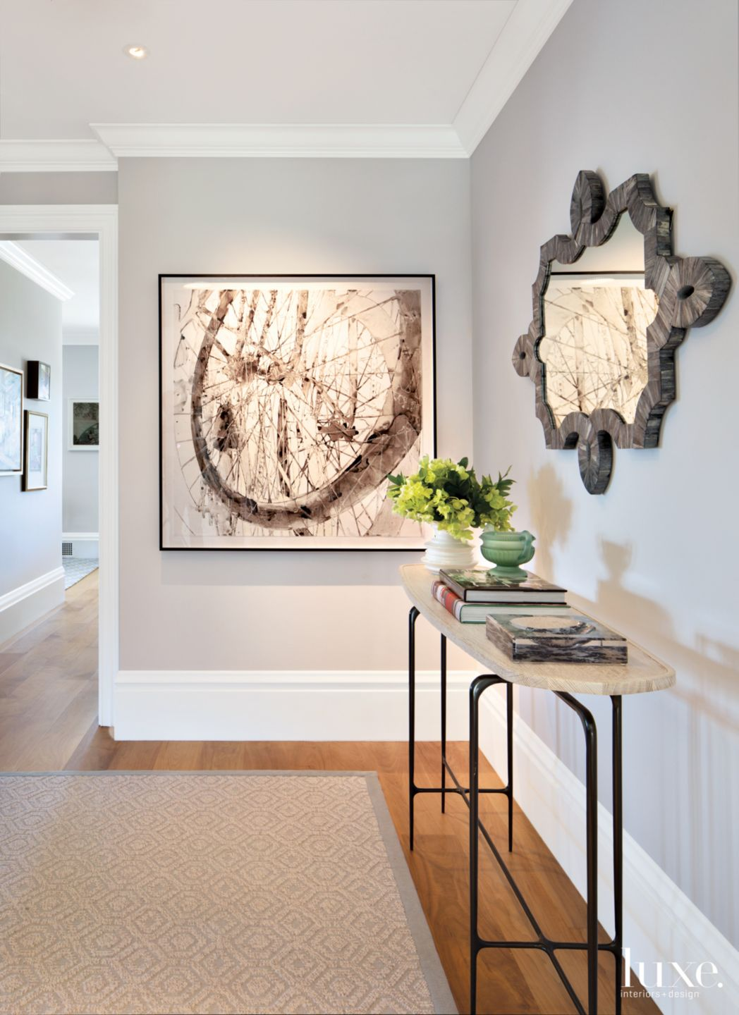 Eclectic Gray Foyer with Sculptural Console
