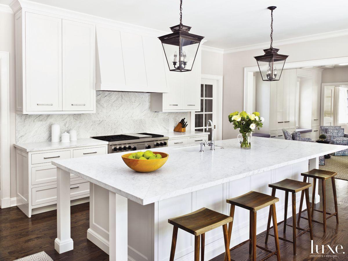 Modern White Kitchen with Hanging Lanterns