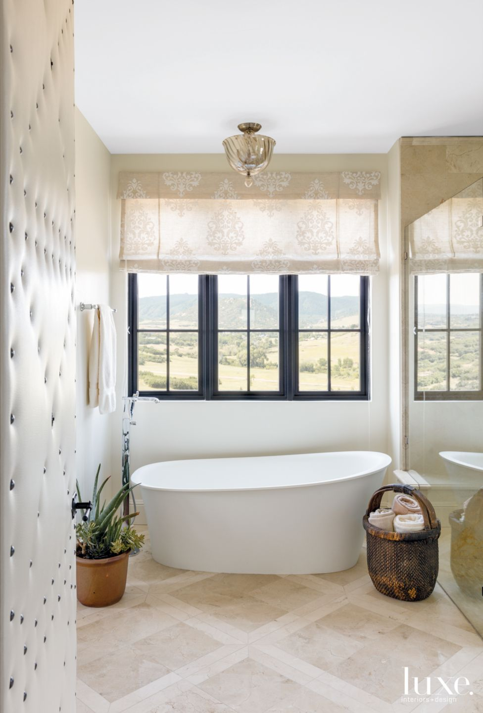 Transitional Cream Bathroom with Tulip Tub