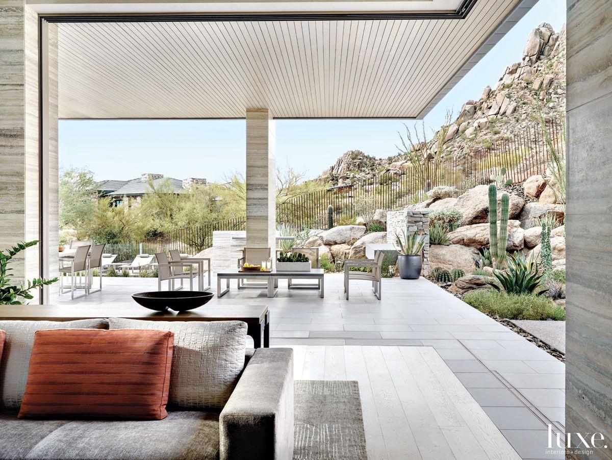 Contemporary Neutral Indoor-Outdoor Space with Motorized Door Panels