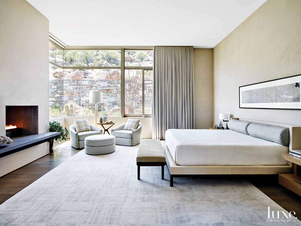 Contemporary Neutral Bedroom with Swivel Chairs