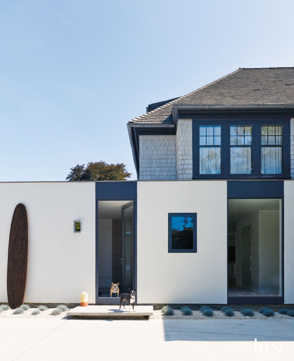 Modern Neutral Exterior with Stucco-and-Steel Addition