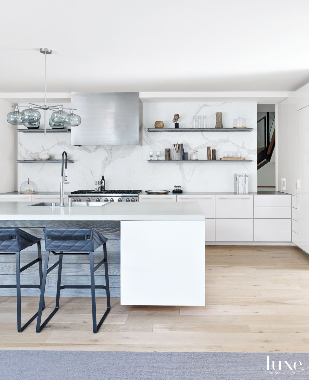 Modern White Kitchen with Quilted-Leather Counter Stools