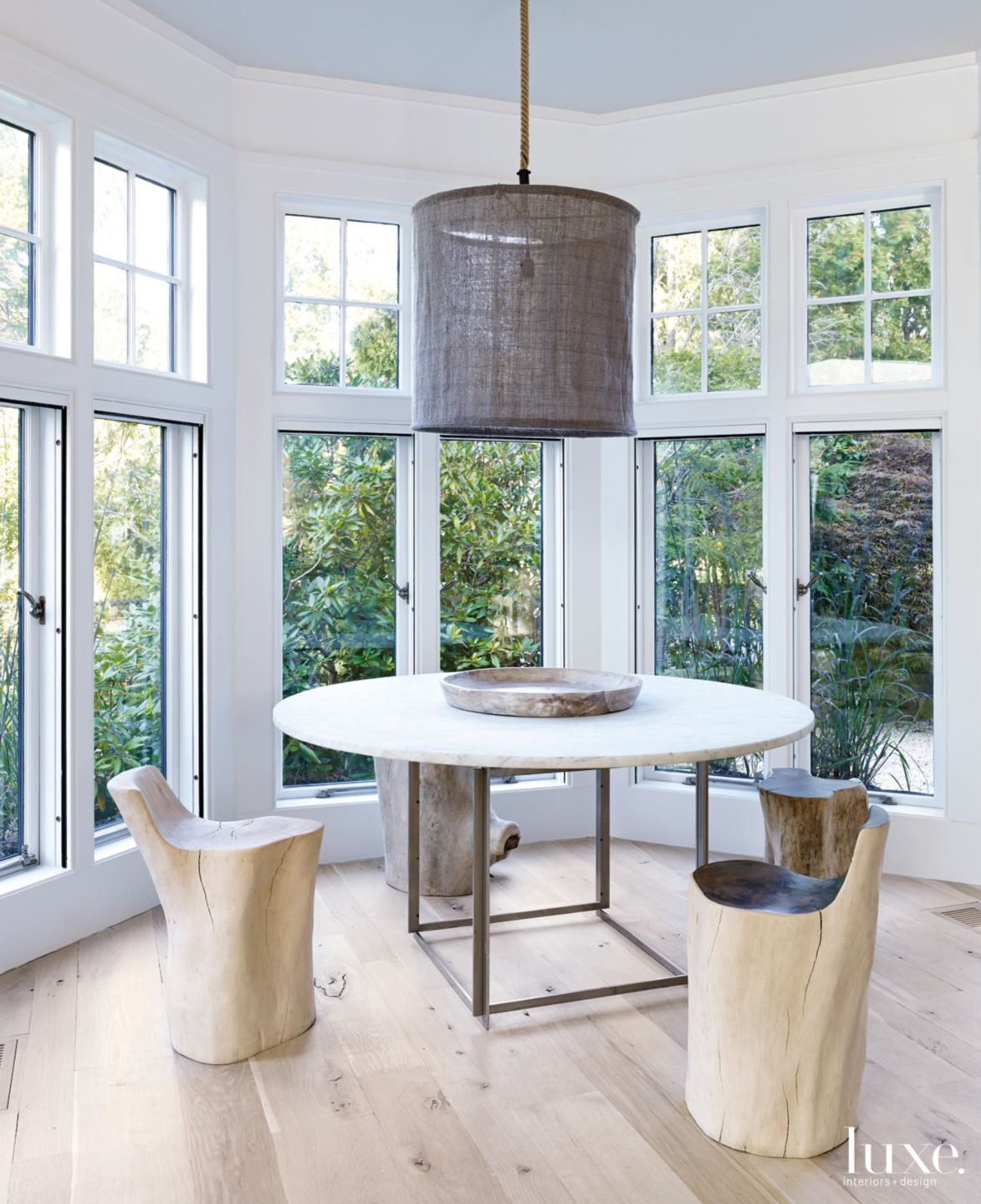 Modern Neutral Breakfast Nook with Tree Trunk Stools