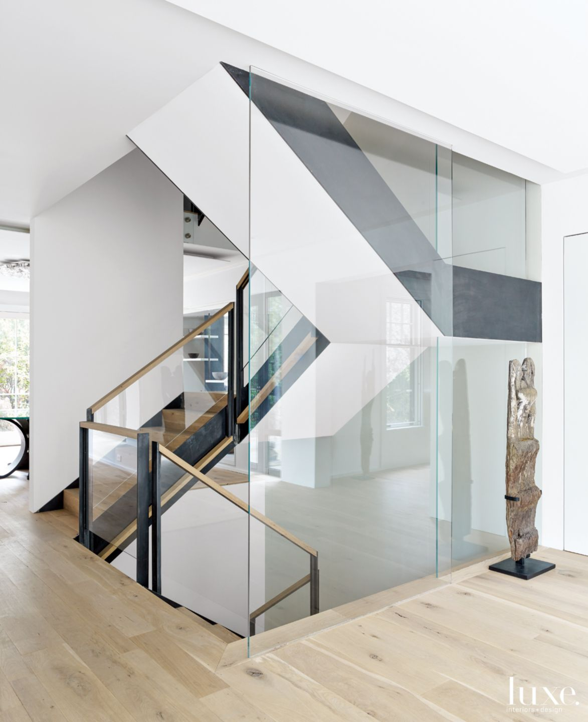 Modern White Staircase with Antique Wood Carving