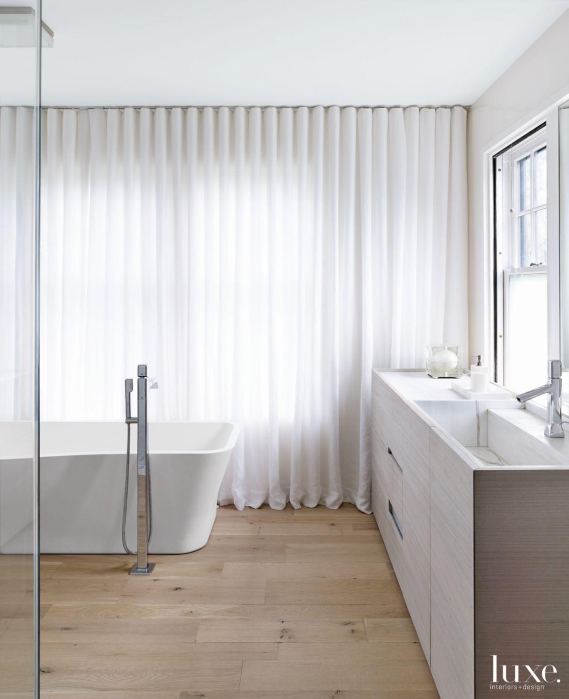 Modern White Bathroom with Oak Flooring