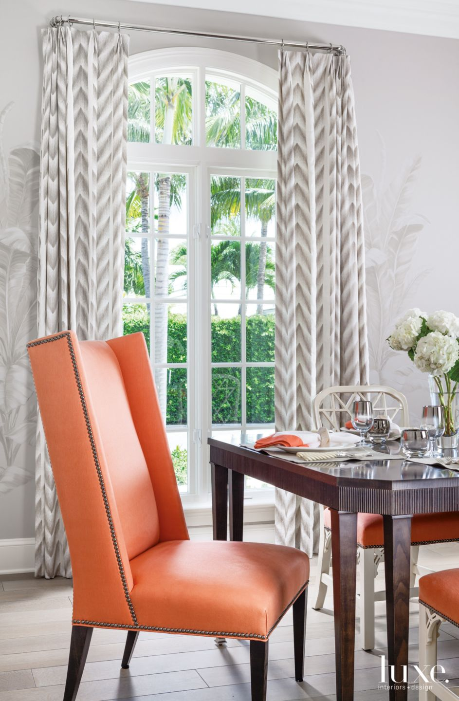 Contemporary White Dining Room with Coral Dining Chairs