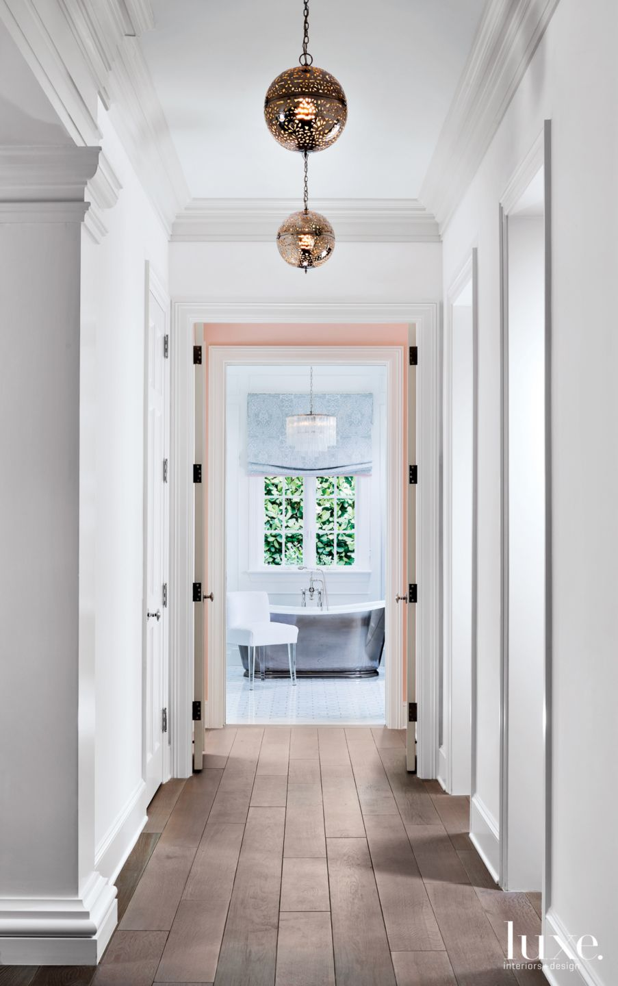 Contemporary White Hallway with Round Pendant Lights