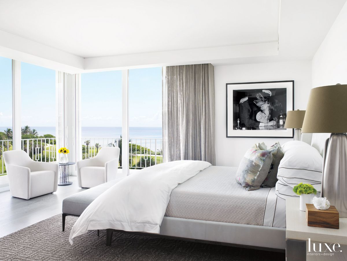 Modern White Bedroom with Black-and-White Photo