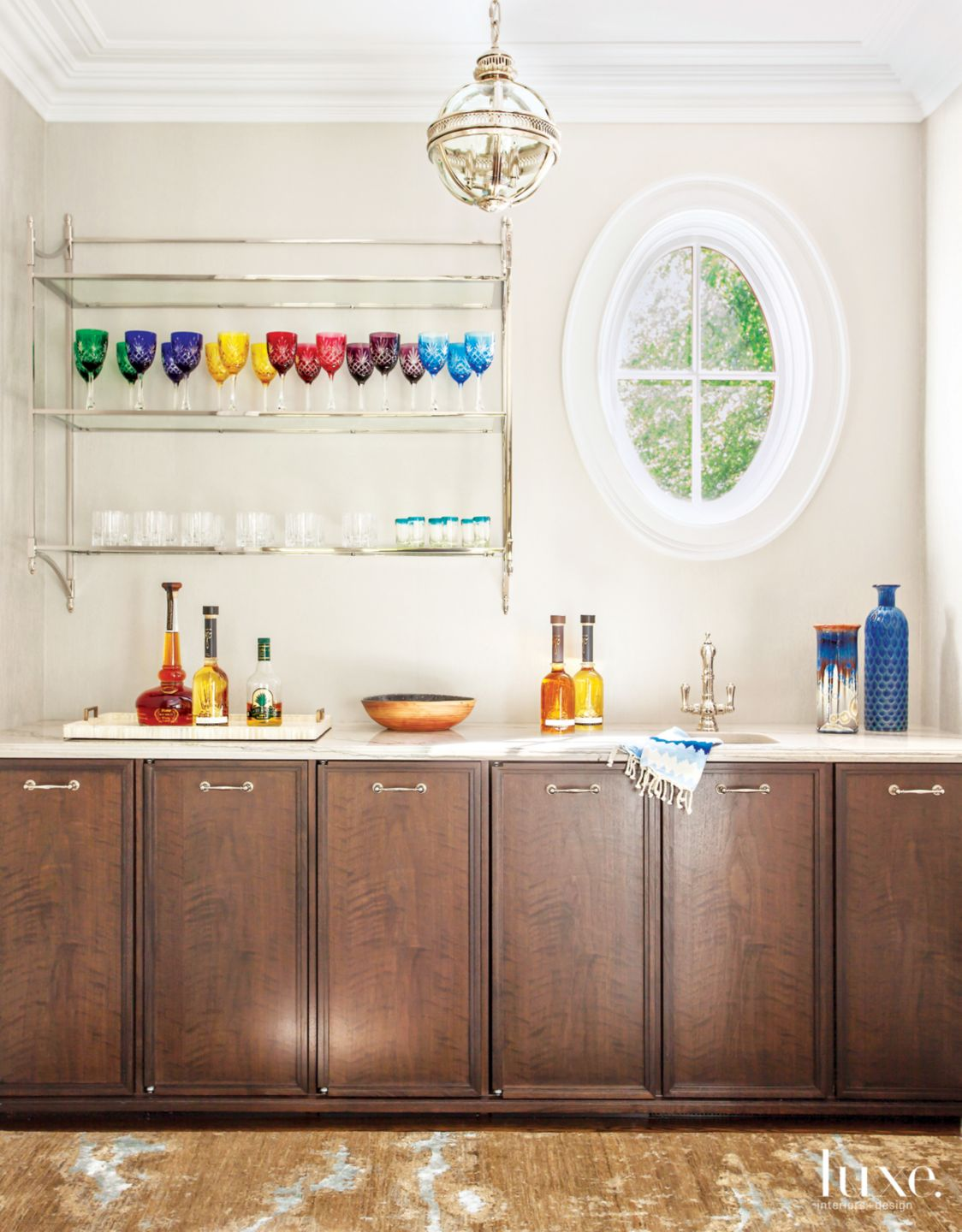 Traditional Neutral Bar Area with Colorful Glassware