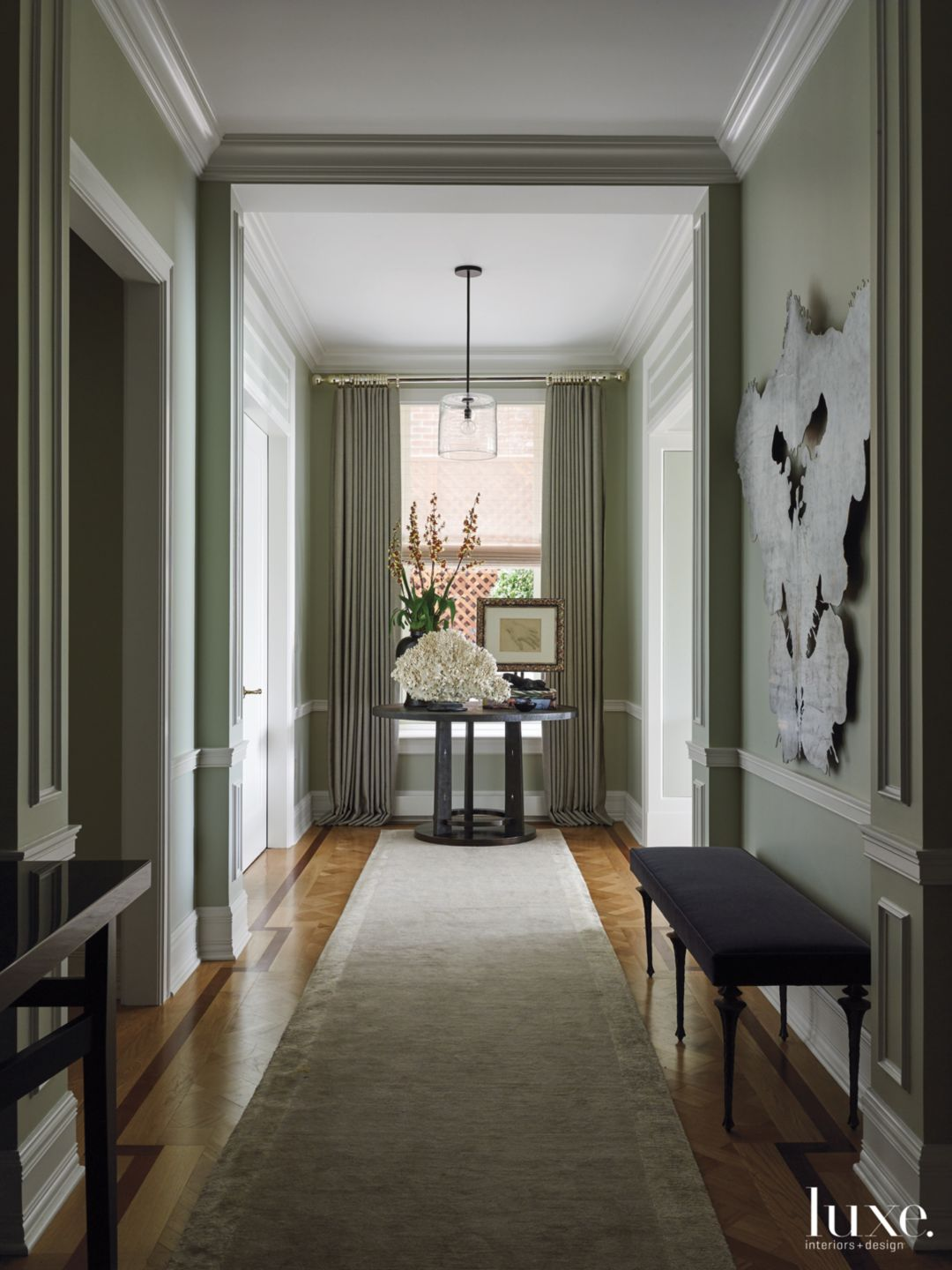 Contemporary Green Hallway with Black Entry Table