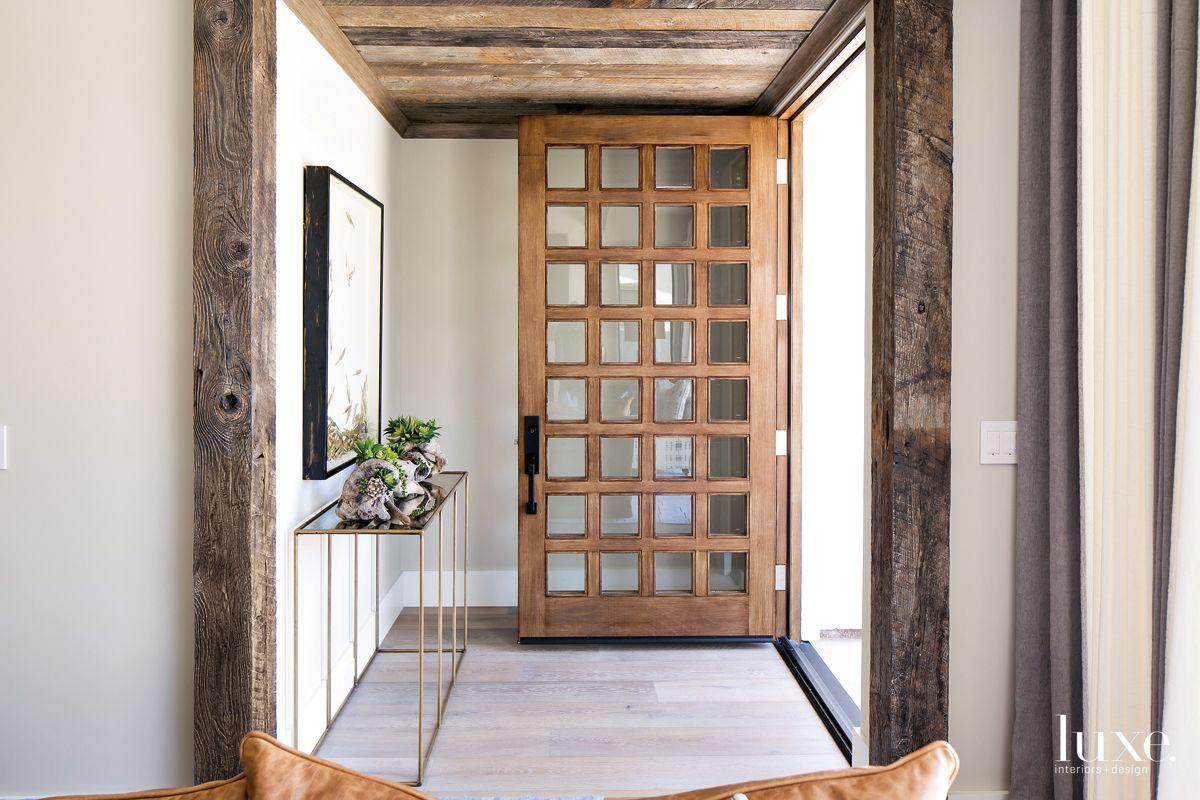 Contemporary Neutral Entry with Rustic Wood Lattice Door