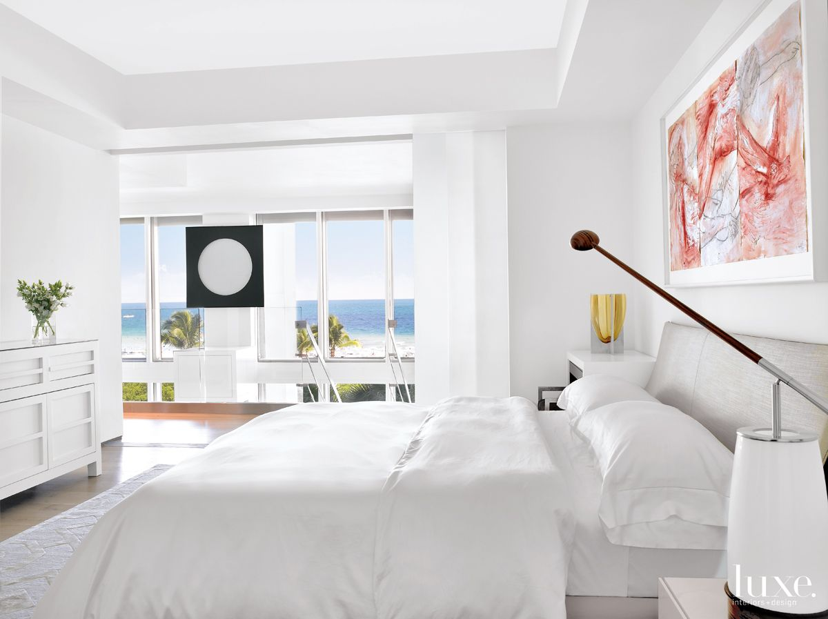 Modern White Bedroom with Expansive Ocean Views