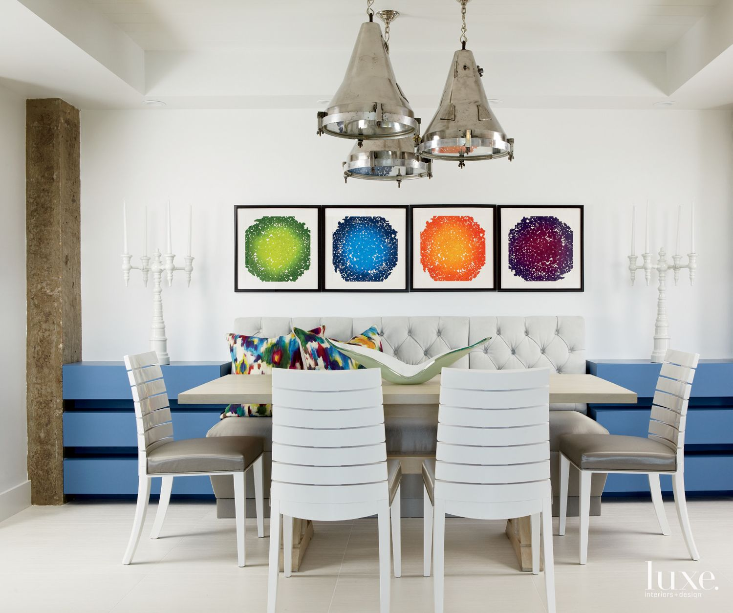 Eclectic White Dining Room with Custom Banquette