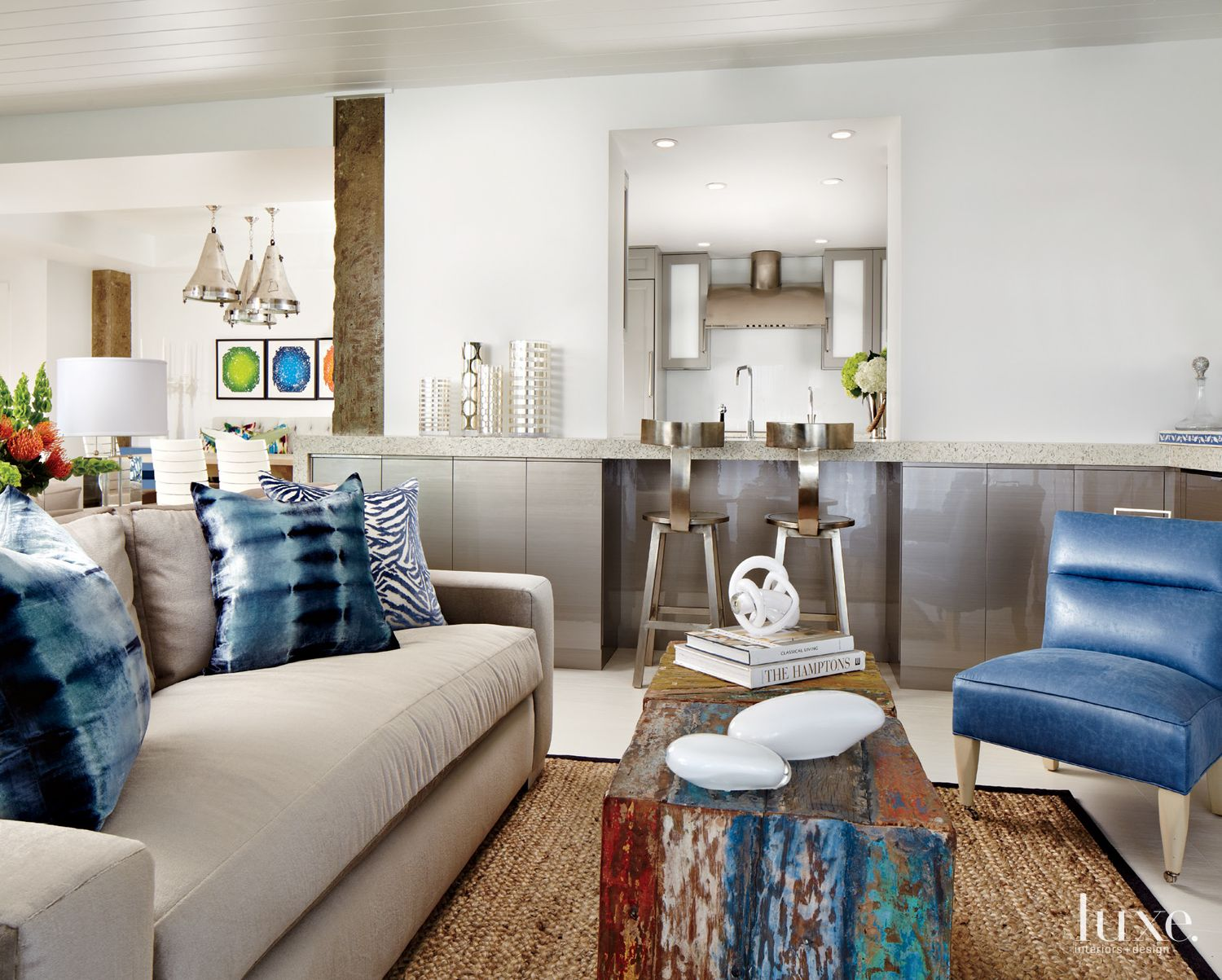 Eclectic White Living Room with Reclaimed Wood Table