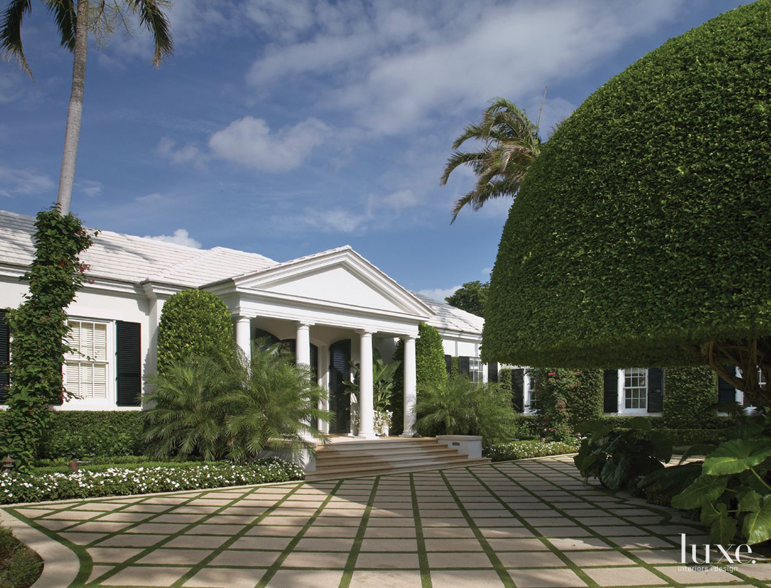 Traditional White Exterior with Extensive Landscaping