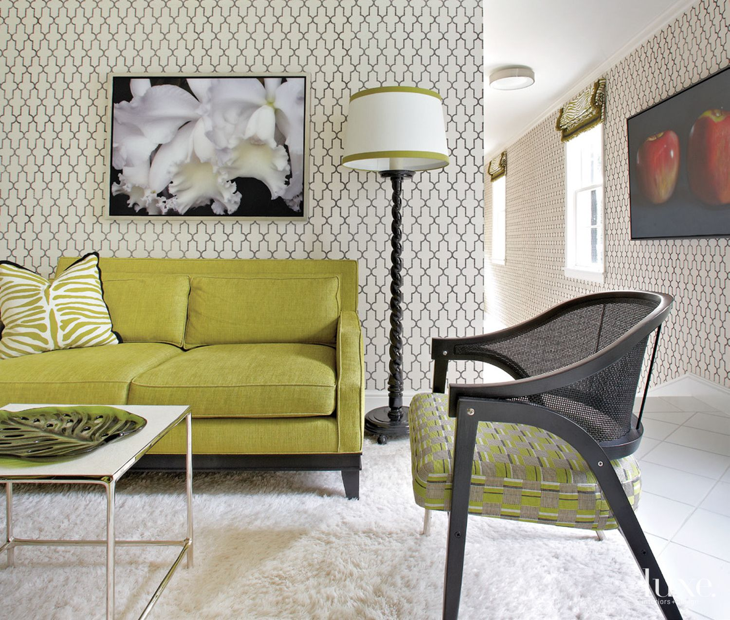 Eclectic White Sitting Area with Patterned Wallpaper