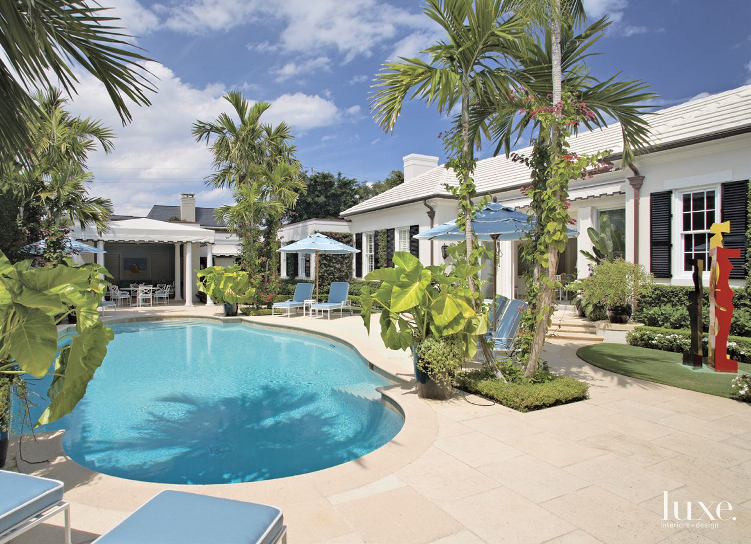 Transitional Neutral Poolside Exterior with Aqua Lounge Chairs