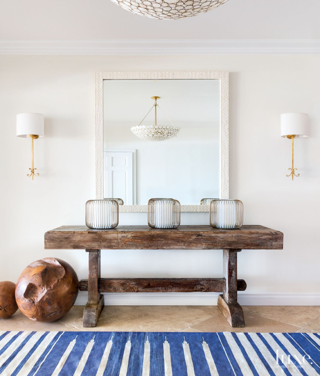 Transitional White Foyer with Twin Sconces