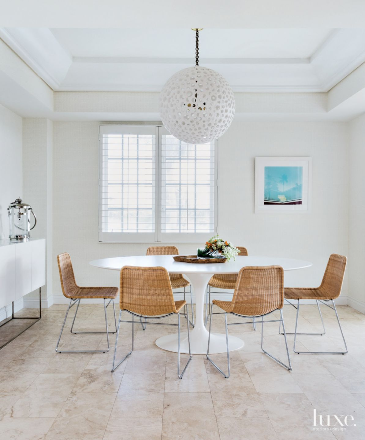 Transitional White Breakfast Area with Saarinen Table