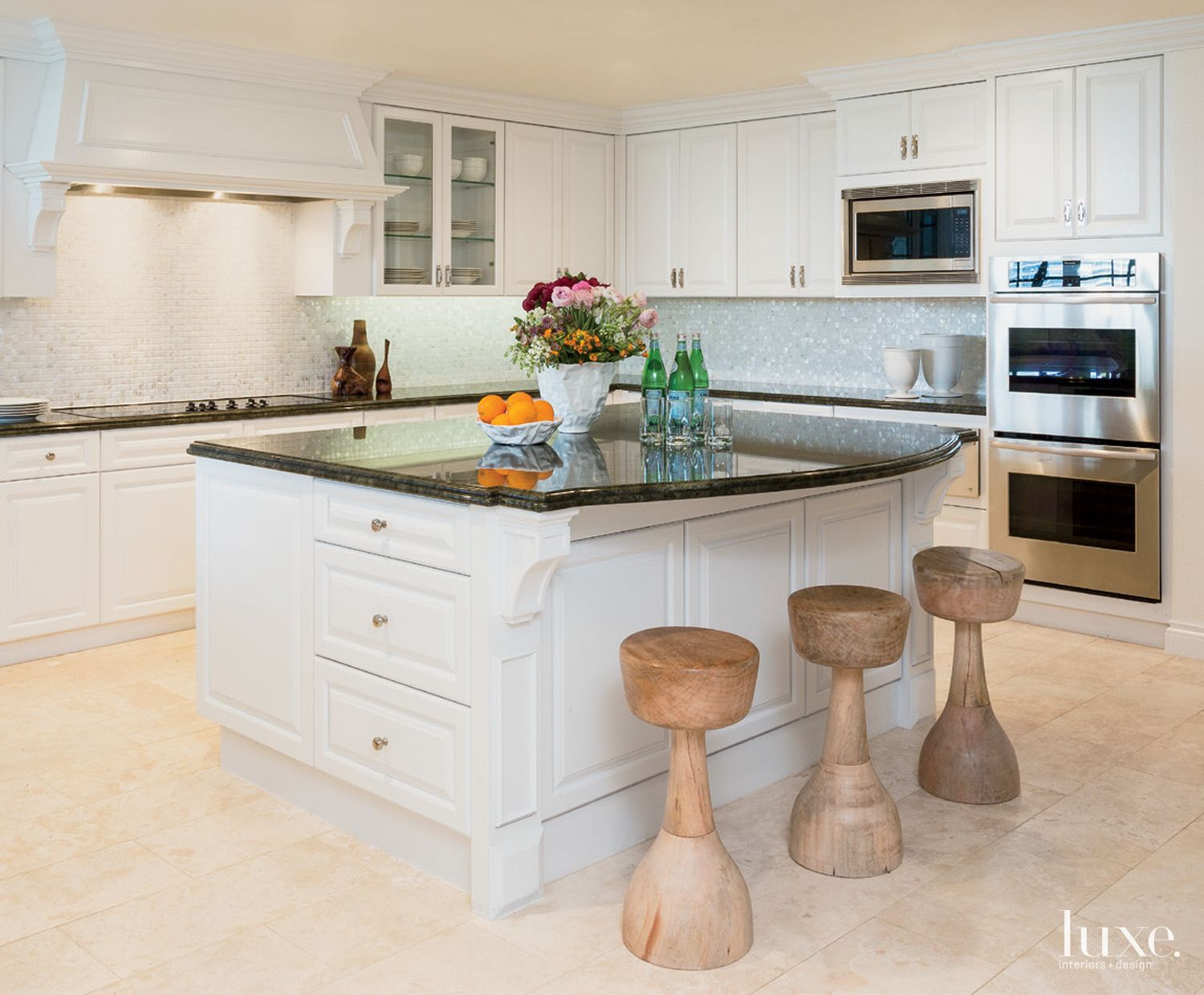 Contemporary White Kitchen with Swivel Stools