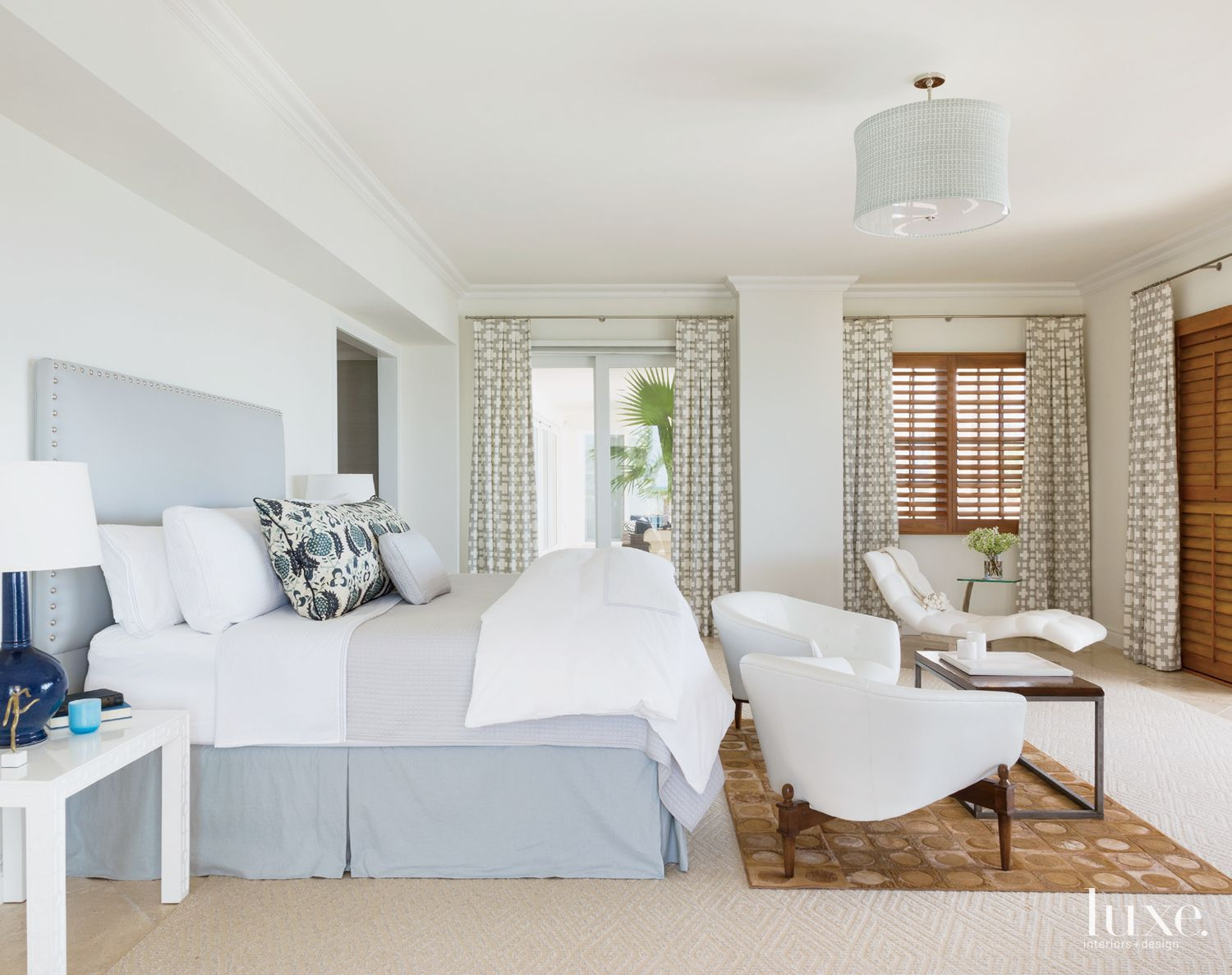 Transitional White Bedroom with Geometric Area Rug