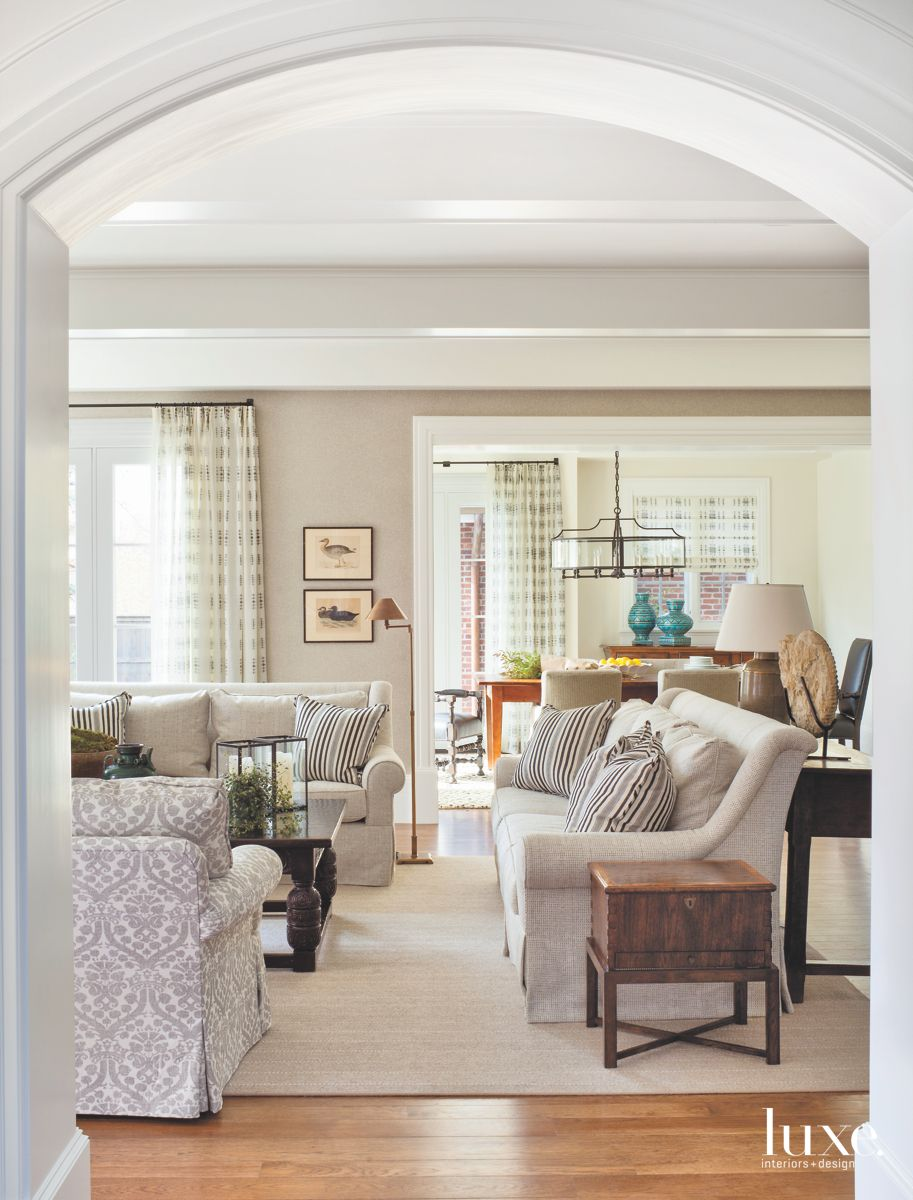 Open Arch Living Room with Sofas and Side Table