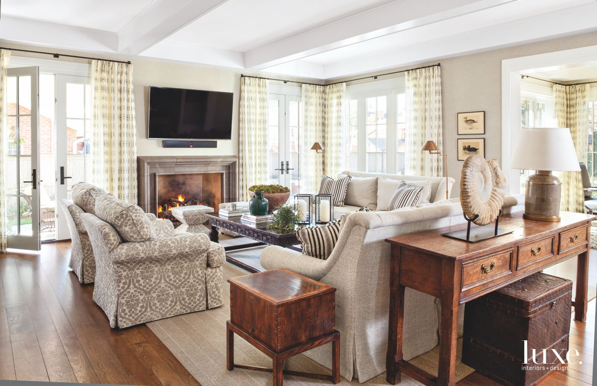 Living Room with Television, Curtains, Sofas, and Wooden Tables
