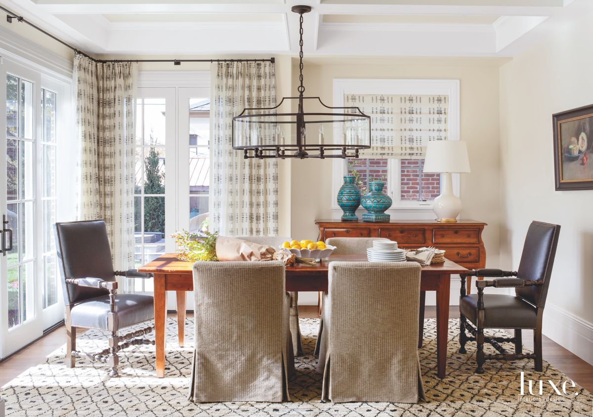 Patterned Rug Dining Room with Curtains and Chandelier