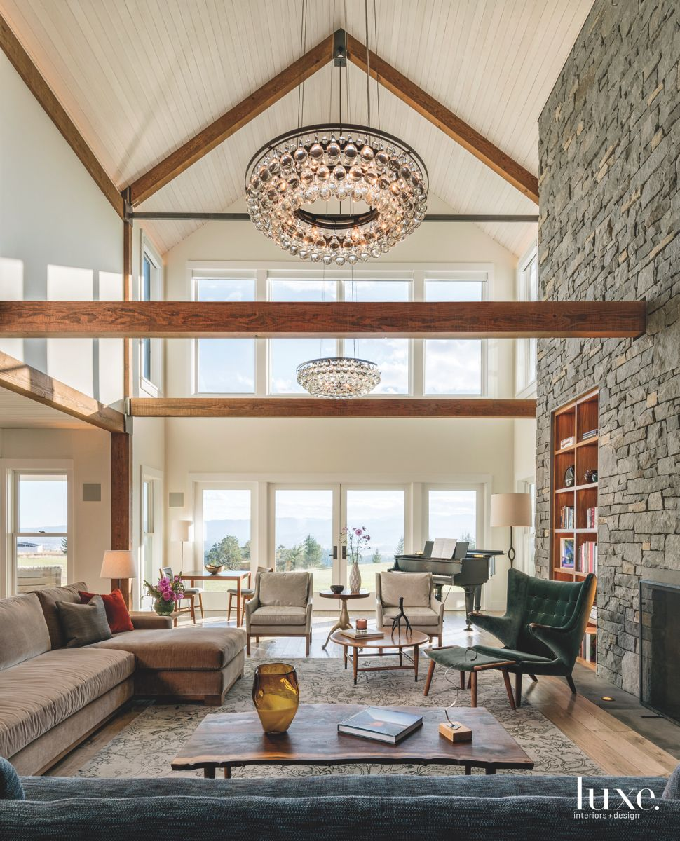 High Ceiling Stone Fireplace Great Room with Chandelier and Wooden Beams