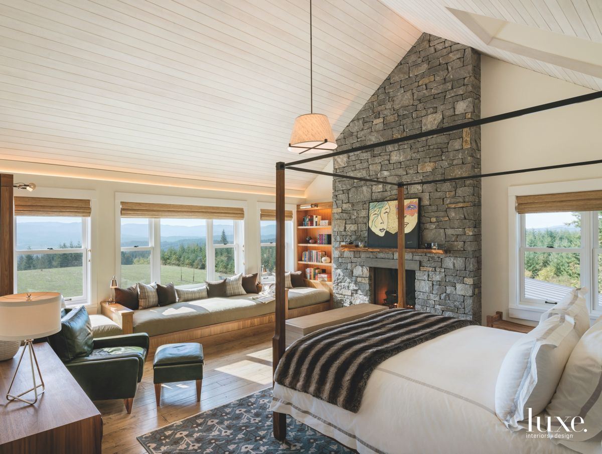 Artwork Master Bedroom with Stone Fireplace Four Poster Bed and Window Seat