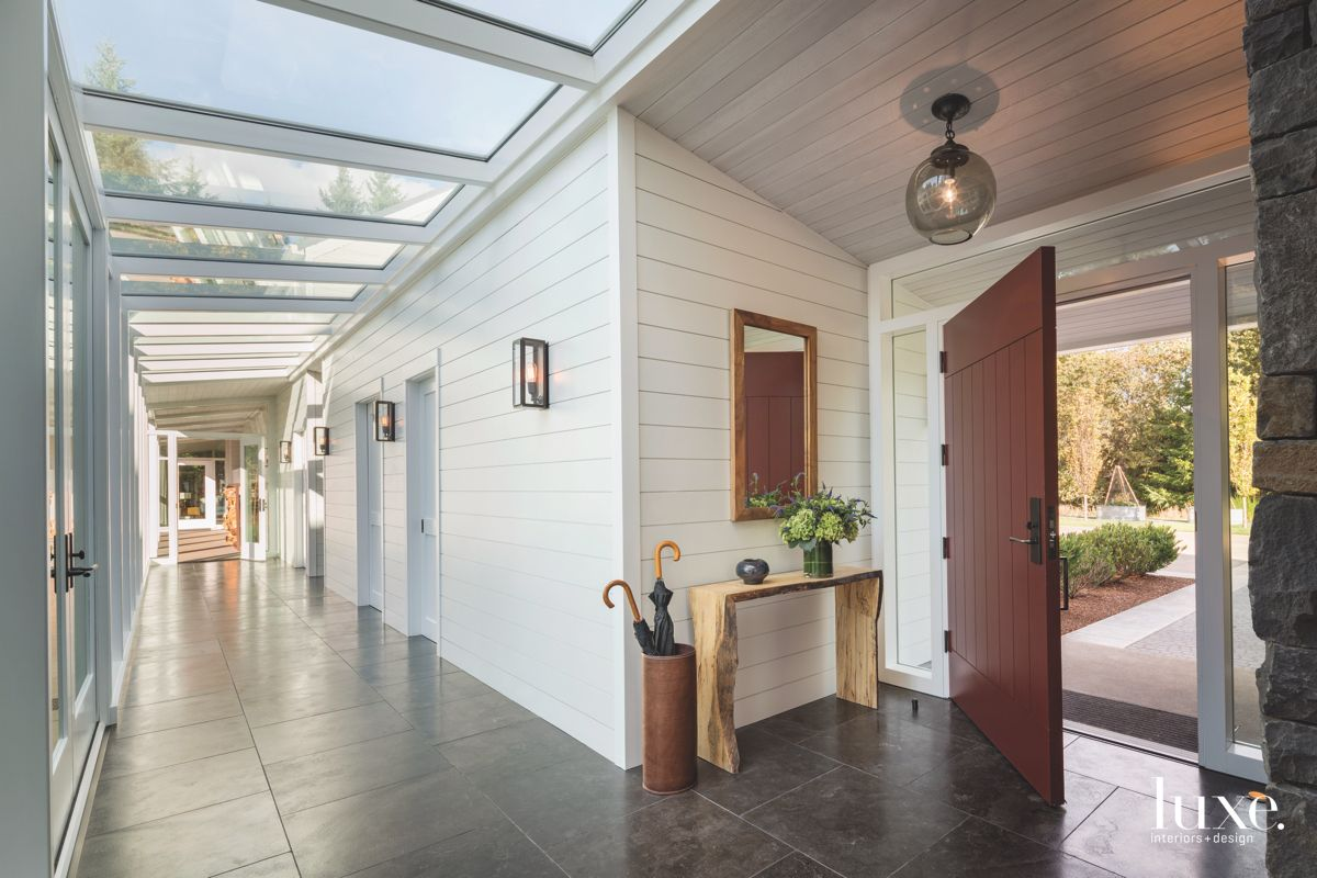 White Siding Hallway with Colorful Barn Door